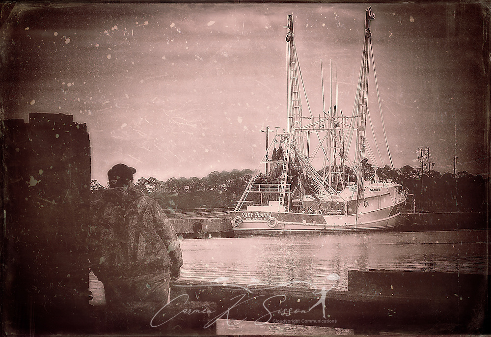 A man stares out at Lady Joanna, a shrimp boat, January 5, 2016, in Bayou La Batre, Alabama. (Photo by Carmen K. Sisson/Cloudybright)