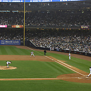 Robinson Cano hits the second of his two home runs for the New York Yankees during the New York Yankees V Boston Red Sox Baseball game which the New York Yankees won 14-2 to become American League East champions at Yankee Stadium, The Bronx, New York. 4th October 2012. Photo Tim Clayton