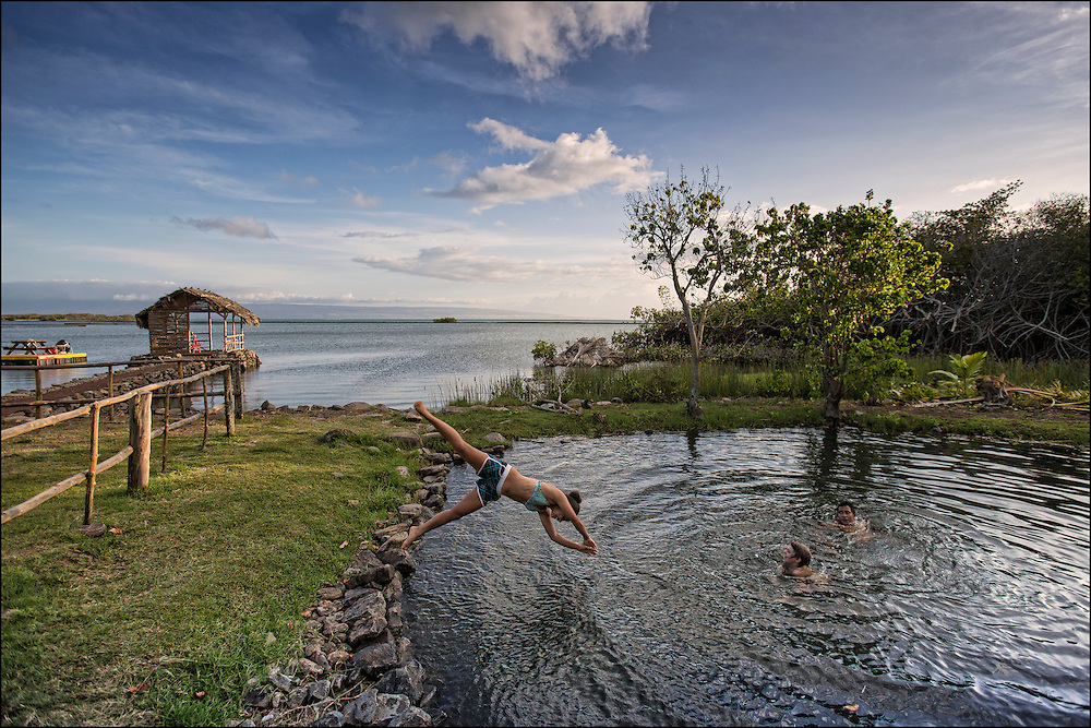 Karina Jacany dives into the freshwater swimming hole at the Keawanui Fishcamp on Molokai.