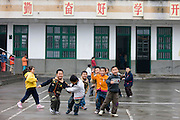 Children playing in the playground of a primary school in Fuli. China has a one child policy to limit population.