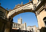 Abbey viewed under arch with deep blue sky, Bath
