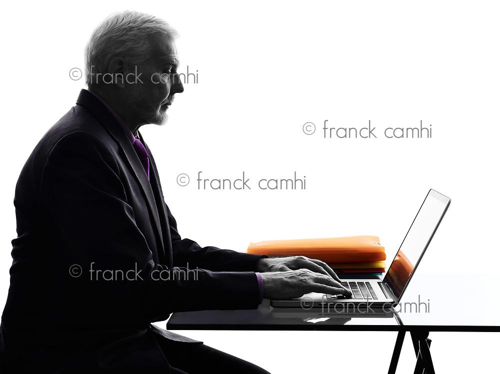 One Caucasian Senior Business Man serious computing laptop Silhouette White Background