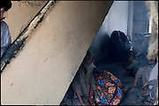 "A marabout, probably heroin user, awakens the interest of poor people of the neighborhood. He will spend time camped between the stairs of a building. Shan Nazar Kapull, Rawalpindi, Pakistan, on thursday, November 27 2008.....""Pakistan is one of the countries hardest hits by the narcotics abuse into the world, during the last years it is facing a dramatic crisis as it regards the heroin consumption. The Unodc (United Nations Office on Drugs and Crime) has reported a conspicuous decline in heroin production in Southeast Asia, while damage to a big expansion in Southwest Asia. Pakistan falls under the Golden Crescent, which is one of the two major illicit opium producing centres in Asia, situated in the mountain area at the borderline between Iran, Afghanistan and Pakistan itself. .During the last 20 years drug trafficking is flourishing in the Country. It is the key transit point for Afghan drugs, including heroin, opium, morphine, and hashish, bound for Western countries, the Arab states of the Persian Gulf and Africa..Hashish and heroin seem to be the preferred drugs prevalence among males in the age bracket of 15-45 years, women comprise only 3%. More then 5% of whole country's population (constituted by around 170 milion individuals),  are regular heroin users, this abuse is conspicuous as more of an urban phenomenon. The substance is usually smoked or the smoke is inhaled, while small number of injection cases have begun to emerge in some few areas..Statistics say, drug addicts have six years of education. Heroin has been identified as the drug predominantly responsible for creating unrest in the society."""