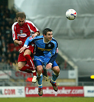 Photo: Chris Ratcliffe.<br />Leyton Orient v Wycombe Wanderers. Coca Cola League 2. 25/03/2006.<br />Wycombe player Ian Stonebridge (R) goes up for a header with Paul Connor of Leyton Orient.