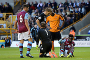 Micah Richards after a strong challenge during the Pre-Season Friendly match between Wolverhampton Wanderers and Aston Villa at Molineux, Wolverhampton, England on 28 July 2015. Photo by Alan Franklin.