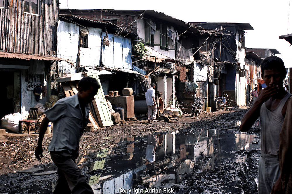 Men use one of the roads on 21st Oct 2006. Drainage can be a particular problem within Dharavi during the monsoon.