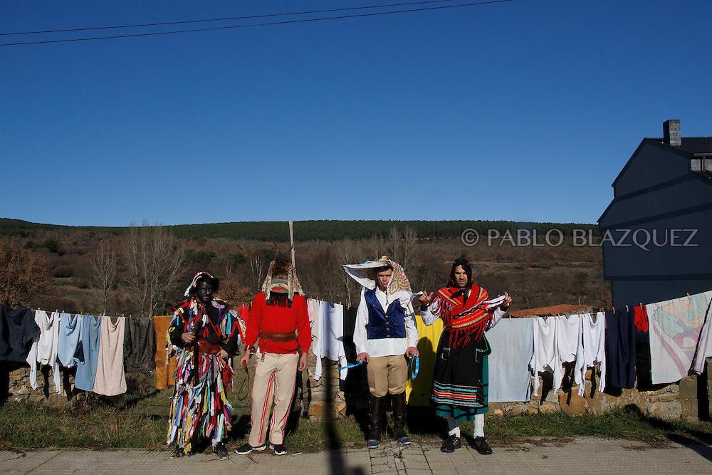 (L-R) Men dressed as La Filandorra, El Diablo, El Galan and La Madama pose for a picture during La Filandorra festival on December 26, 2016 in the small village Ferreras de Arriba, Zamora province, Spain.  La Filandorra festival is a pagan winter masquerade that takes place during Saint Esteban festivities. The parade is represented by four characters, La Filandorra, El Diablo (Devil), La Madama (madame) y El Galán (Gallant). (© Pablo Blazquez)