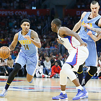 24 February 2016: Denver Nuggets guard Gary Harris (14) drives past Los Angeles Clippers forward Luc Richard Mbah a Moute (12) and Los Angeles Clippers guard J.J. Redick (4) on a screen set by Denver Nuggets forward Danilo Gallinari (8) during the Denver Nuggets 87-81 victory over the Los Angeles Clippers, at the Staples Center, Los Angeles, California, USA.