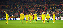 BRUSSELS, BELGIUM - Sunday, November 16, 2014: Wales' players celebrate a point and staying top of the group after the final whistle of a goal-less draw against Belgium during the UEFA Euro 2016 Qualifying Group B game at the King Baudouin [Heysel] Stadium. Chris Gunter, Hal Robson-Kanu, George Williams, Neil Taylor, captain Ashley Williams, goalkeeper Wayne Hennessey, Emyr Huws, Aaron Ramsey, Gareth Bale. (Pic by David Rawcliffe/Propaganda)
