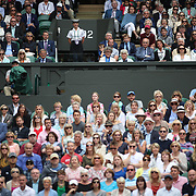 LONDON, ENGLAND - JULY 14: Able Seaman Henrietta Goodrum, (center), in her role as a service steward on Center Court during the Gentlemen's Singles Semi-finals of the Wimbledon Lawn Tennis Championships at the All England Lawn Tennis and Croquet Club at Wimbledon on July 14, 2017 in London, England. (Photo by Tim Clayton/Corbis via Getty Images)