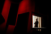 A portrait of a Vietnamese studio head in a recording room in HCMC, Vietnam.