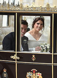 Princess Eugenie and her new husband Jack Brooksbank take a carriage procession around Windsor following their wedding at St George's Chapel in Windsor Castle.