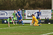 Forest Green Rovers Christian Doidge(9) heads the ball Macclesfield's goalkeeper Scott Flinders makes a save during the Vanarama National League match between Forest Green Rovers and Macclesfield Town at the New Lawn, Forest Green, United Kingdom on 4 March 2017. Photo by Shane Healey.