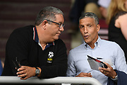 Former Brighton manager Chris Hughton chats with Talksports presenter Ian Abrahams during the Pre-Season Friendly match between Northampton Town and Sheffield United at the PTS Academy Stadium, Northampton, England on 20 July 2019.