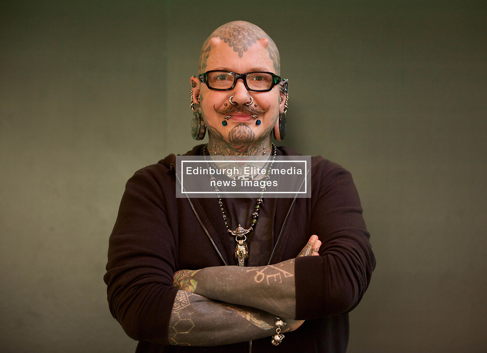 Muffe Vulnuz, 52, who runs a piercing studio in Copenhagen, was among those from The Human Library charity who took part in the launch of Scotland's first 'book depot' – people who have experienced prejudice – at the Edinburgh head office of the charity's sponsor Heineken UK to promote inclusion and diversity.  Pic: Terry Murden @edinburghelitemedia