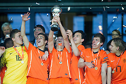Mike Havekotte of Netherlands, Rai Vloet of Netherlands,  Jorrit Hendrix of Netherlands, Thom Haye of Netherlands, Joris Voest of Netherlands, Wouter Marinus of Netherlands celebrate with a trophy after winning the UEFA European Under-17 Championship Final match between Germany and Netherlands on May 16, 2012 in SRC Stozice, Ljubljana, Slovenia. Netherlands defeated Germany after penalty shots and became European Under-17 Champion 2012. (Photo by Vid Ponikvar / Sportida.com)