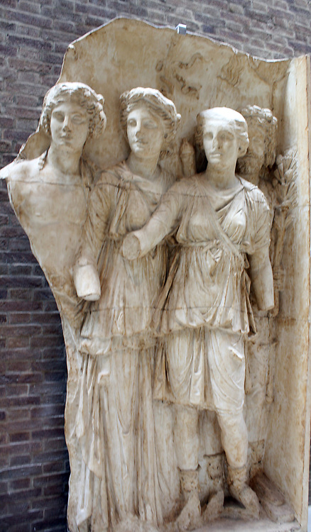 Gods of countryside.  Arch of Trajan at Beneventum, AD 114.  These gods represent the prosperity of the countryside : Bacchus, god of the vine with his thyrsos (a fennel-stalk staff); Ceres, goddess of corn and the harvest, with a torch; Diana, goddess of hunting and wild animals; and Silvanus, god of woods and fields, who holds a pine branch.