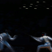 Guilherme Toldo, Brazil and Race Imboden, USA, in action in the Men's Foil Individual event during the Fencing competition at ExCel South Hall during the London 2012 Olympic games. London, UK. 31st July 2012. Photo Tim Clayton