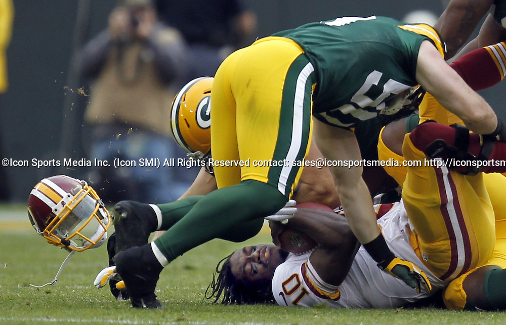 Sept. 15, 2013 - Green Bay, WI, USA - Washington Redskins' Robert Griffin III is sacked in the 1st quarter by Green Bay Packers' Clay Matthews and A.J. Hawk at Lambeau Field in Green Bay, Wisconsin, on Sunday, September 15, 2013