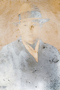 deteriorating and fading portrait of an adult man wearing a hat Japan ca 1950s