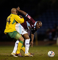 Photo: Jed Wee.<br /> Burnley v Norwich City. Coca Cola Championship. 24/03/2006.<br /> <br /> Norwich's Leon McKenzie (L) is muscled away from the ball by Burnley's Frank Sinclair.