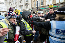 "© Licensed to London News Pictures . 09/02/2019. Manchester , UK . Scuffles break out as anti-fascists block a "" Yellow Vest "" protest on Market Street in Manchester City Centre . The yellow vest concept has been adopted from French demonstrators by some British groups in support of Brexit , Donald Trump and former EDL leader Stephen Yaxley-Lennon - aka Tommy Robinson . A similar demonstration in the city in January was ridiculed after protesters were kettled by police in front of a branch of Greggs the Baker . Photo credit : Joel Goodman/LNP"