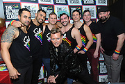 Patrik Gallineaux, center, LGBT Ambassador for Stoli, poses with the seven bartenders competing in The Stoli Key West Cocktail Classic New York Regional Competition, Wednesday, Feb. 24, 2016, at Boxers HK in New York. The winner will go on to compete for the 2016 Champion title in Key West during Key West Pride 2016 and receive $10,000 for charity. (Diane Bondareff/Invision for Stoli Vodka/AP Images)