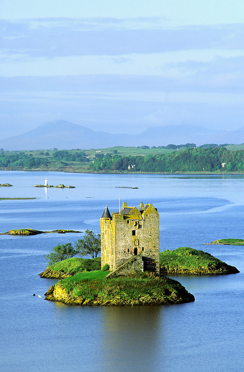 Castle Stalker on Loch Linnhe with Lismore Island behind in middle distance. Summer.  Strathclyde Region, west Scotland, UK
