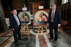UK ENGLAND LONDON 5MAY12 - Trustees William Edwards (71, R) and Timothy Benoy (69) stand in front of the De Brecy Tondo artwork, suspected to be by Reniassance painter Rafael at the Westminster Cathedral in central London...The Tondo displays striking resemblance to Rafael's Sistine Madonna, finished as a commissioned altarpiece and the last painting he completed with his own hands a few years before his death...Relocated to Dresden from 1754, the well-known painting has been particularly influential in Germany...jre/Photo by Jiri Rezac....© Jiri Rezac 2012