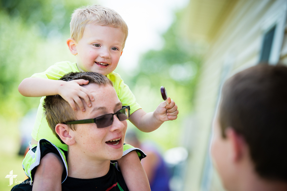 Jude Shady sits on his brother Logan's shoulders during the grand opening of the Iowa Life Care (LC) Clinic on Saturday, Aug. 15, 2015, in Creston, Iowa. LCMS Communications/Erik M. Lunsford