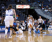 Atlanta Dream's Shalee Lehning injures her shoulder in a collision with  Washington Mystic's Lindsey Harding  while going after a loose ball.  Lehning injured her left shoulder and left the game