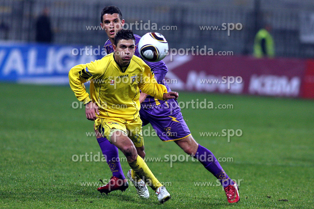 Tadej Apatic of Domzale vs Vito Plut of Maribor  during the football match between NK Maribor and NK Domzale, played in the 18th Round of Prva liga football league 2010 - 2011, on November 20, 2010, at Stadium Ljudski vrt, Maribor, Slovenia.  (Photo by Marjan Kelner / Sportida)