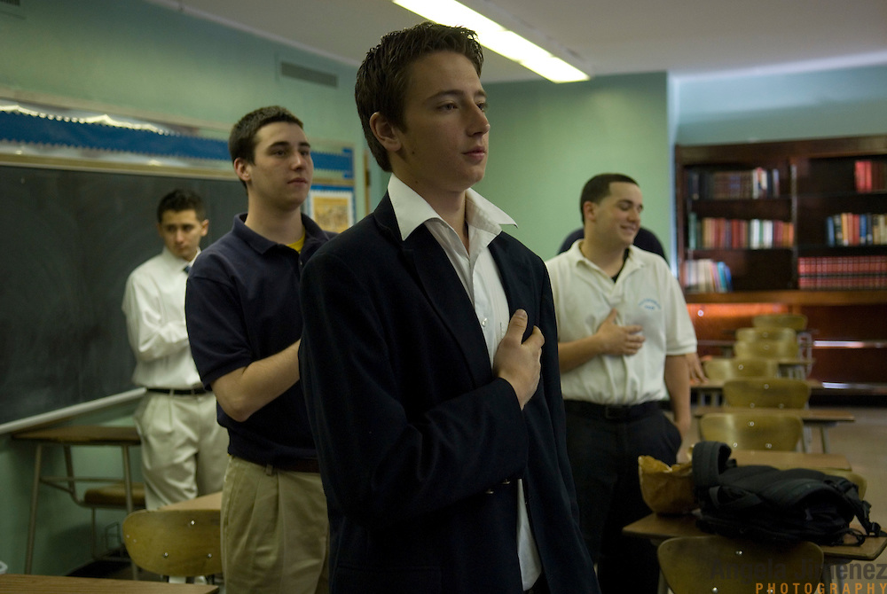 Date: 4/25/2008..Desk: MET..Slug: ..Assign Id: ....Senior students, from left, Jose Rodriguez, Neil McCarthy, Adrian Wlostowski and Andrew Viola-Lopez recite the daily Pledge of Allegiance during morning announcement in homeroom at the Cathedral Preparatory Seminary in Elmhurst, Queens on April 25, 2008. ....Photo by Angela Jimenez for The New York Times ..photographer contact 917-586-0916