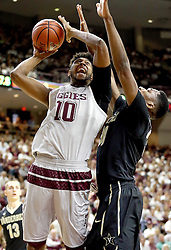 Texas A&M's Tonny Trocha-Morelos goes up for a shot against Vanderbilt's Damian Jones during the first half of an NCAA college basketball game, Saturday, March 5, 2016, in College Station, Texas. (AP Photo/Sam Craft)
