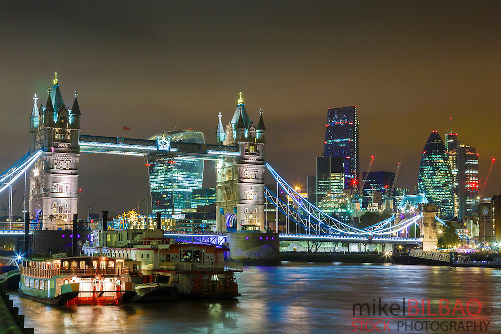 Tower Bridge, the City buildings and River Thames at night. London, United Kingdom, Europe