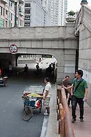 fruit seller and locals walking in Shanghai China