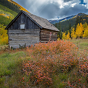 A long since abandoned house at Ashcroft Ghost Town, once a thriving mining town in Castle Creek Valley near Aspen, Colorado. Founded in 1880, there was once such a mining boom there that the town had 2,500 residents, two newspapers, a school, saw mill and 20 saloons. The town dwindled as the mines played out, and by 1900, there were only two people left. Ashcroft has since become a National Register Historic Site preserved by the Aspen Historical Society.