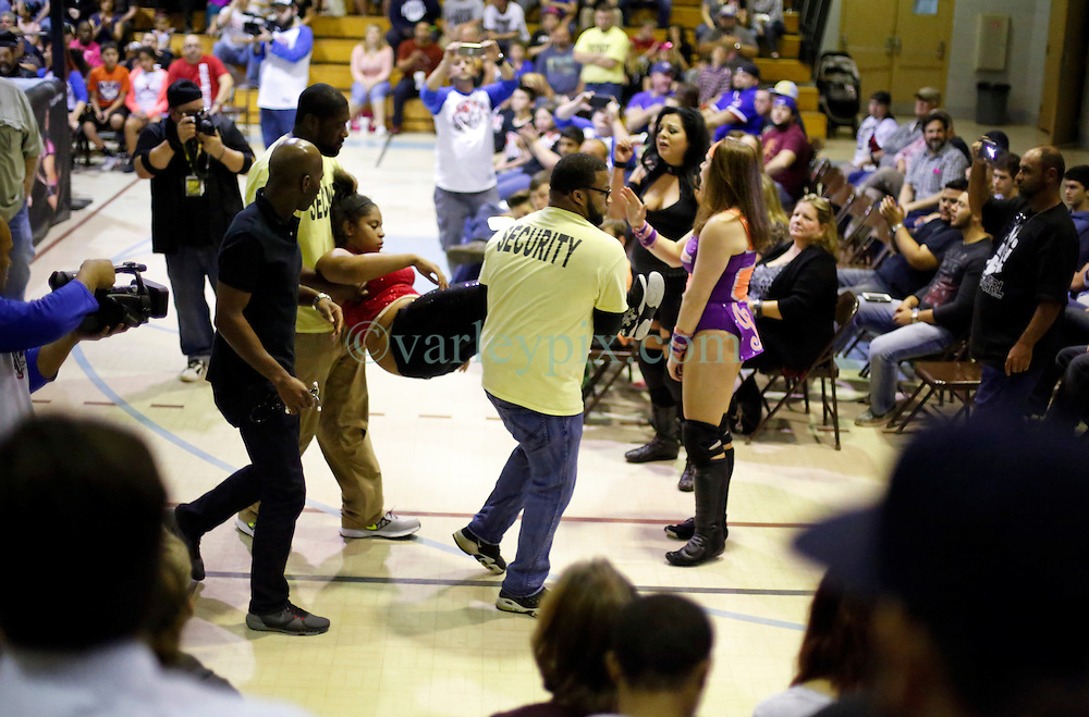 12 March 2016. Metairie, Louisiana.<br /> Wrestling action from Wildkat Sports and Entertainment's 'March into Mayhem' at the Meisler Middle School.<br /> Ruby Raze and Kennadi Brink defeat Renee Michelle. Amaiya Jade is taken away with concussion.<br /> Photo&copy;; Charlie Varley/varleypix.com
