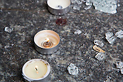 Brussels 23 March 2016 small candles were lit at a subway entrance where the floor is filled with shattered glass and some bloodstains