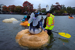 Paddlers prepare to race giant pumpkins across Lake of the Commons at the 14th annual West Coast Giant Pumpkin Regatta in Tualatin, Ore. on October 21, 2017. (Photo by Alex Milan Tracy)
