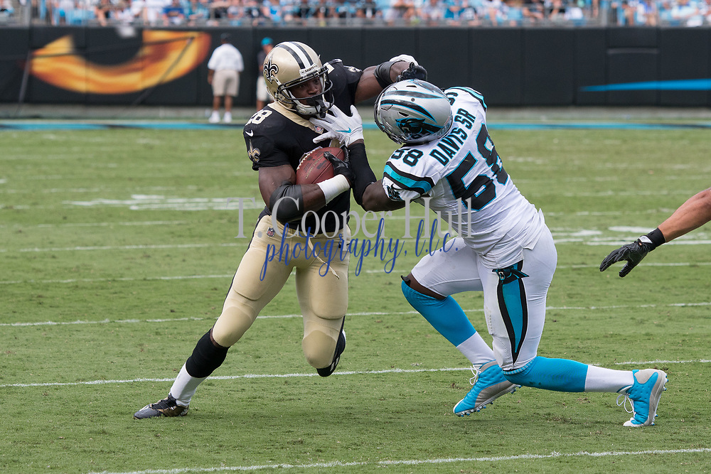 Adrian Peterson(28) takes on Thomas Davis(58) in the New Orleans Saints 34 to 13 victory over the Carolina Panthers.