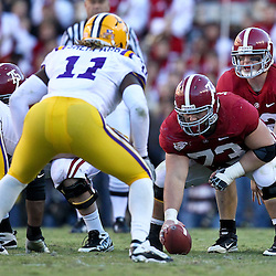 November 6, 2010; Baton Rouge, LA, USA;  Alabama Crimson Tide quarterback Greg McElroy (12) lines up under center William Vlachos (73) during the second half against the LSU Tigers at Tiger Stadium. LSU defeated Alabama 24-21.  Mandatory Credit: Derick E. Hingle