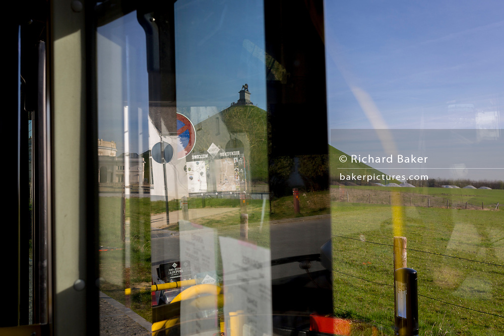 From a tour bus is the Lion's Mound on the Waterloo battlefield,  on 25th March 2017, at Waterloo, Belgium. The Battle of Waterloo was fought on 18 June 1815. A French army under Napoleon Bonaparte was defeated by two of the armies of the Seventh Coalition: an Anglo-led Allied army under the command of the Duke of Wellington, and a Prussian army under the command of Gebhard Leberecht von Blücher, resulting in 41,000 casualties.