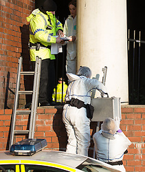 © Licensed to London News Pictures . 20/01/2016 . Manchester , UK . Police and forensic examiners at the scene where a man was found burned to death inside a tent , under a railway arch near to Salford Central railway station on the edge of Manchester City Centre , this morning (20th January 2016) . Photo credit: Joel Goodman/LNP
