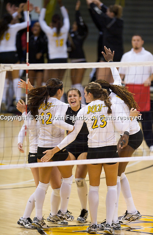 The 49ers celebrate the point in the Big West Conference game against Cal Poly at the Walter Pyramid, Long Beach CA, Saturday Oct. 3, 2009.