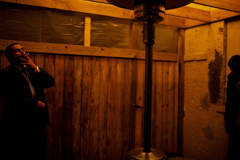 A bar-goer smokes a cigarette outside of The Village Idiot in Columbus, Ohio on Friday, February 25, 2011. Senate Bill 5 would eliminate collective bargaining rights for state workers, which Governor John Kasich claims is a necessary reaction to the budget crisis.