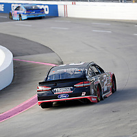 Brad Keselowski (2) races through turn three to practice  for the First Data 500 at Martinsville Speedway in Martinsville, Virginia.
