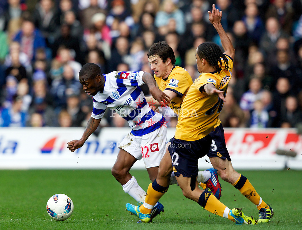 LONDON, ENGLAND - Saturday, March 3, 2012: Everton's Steven Pienaar and Leighton Baines in action against Queens Park Rangers' Shaun Wright-Phillips during the Premiership match at Loftus Road. (Pic by Vegard Grott/Propaganda)