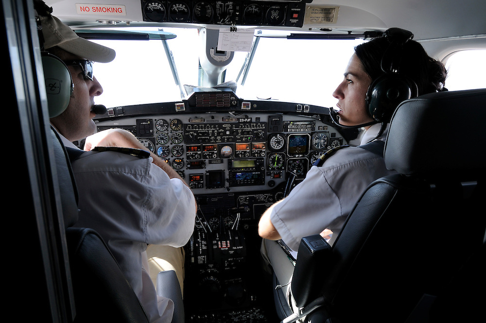 """Pilot, Danielle Aitchison, and her partner Captain Chris Hood discuss their flight from Kabul to Bamiyan airport in the UNHAS Beechcraft 1900D.  Danielle flies in Afghanistan for The United Nations Humanitarian Air Service (UNHAS).   ...When asked about flying in a war zone, she says,  """"I'm just a normal average female.  My job is maybe a little different to some, but I have the same feminine side as other women.  I don't have any trouble going back to New Zealand relating to people.  I'm just a regular chick.""""."""