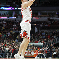 10 March 2012: Chicago Bulls power forward Brian Scalabrine (24) takes a jumpshot during the Chicago Bulls 111-97 victory over the Utah Jazz at the United Center, Chicago, Illinois, USA.